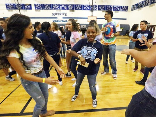 Incoming Chapin freshman Taleah Hays, center, dances with Chapin sophomore Anayancy Campos, left, during the school's Fishing Freshmen Camp for incoming students Friday in the school's gymnasium. Hays moved in November to El Paso from Springfield, Mass. When the doors open Monday, the Northeast school is expecting an influx of about 540 new students.