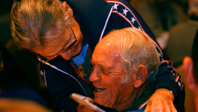 In 2002, 83-year-old World War ll veteran Desmond Doss (left), a conscientious objector who served as a medic during the war, jokes with fellow Congressional Medal of Honor Recipient John Finn, who is the society's oldest member at 96 years old, at a mayor's banquet in Shreveport honoring the medal recipients.-