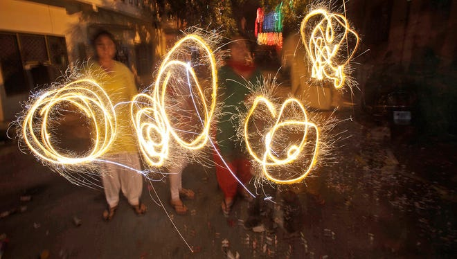 People in Jammu, India, handle fireworks to celebrate Diwali, the Hindu festival of lights.