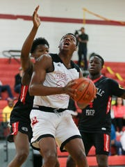 Aspire Academy's Charles Bassey (23) worked against the Orangeville Prep defense at Seneca High School.  