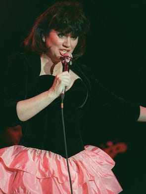 Ten-time Grammy Award winner Linda Ronstadt, at 67, no longer sings and is battling Parkinson's disease.  However, the singer is scheduled to be inducted into the Rock and Roll Hall of Fame on April 10, 2014.  Though Ronstadt was versatile in many musical genres, she was widely known as the Queen of Rock or Queen of Country Rock in the 1990s. She's seen here performing in 1997.