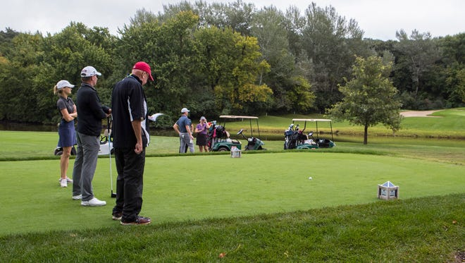 Golfers prepare to tee off during the Sanford International at Minnehaha Country Club on Wednesday, Sept. 19, 2018 in Sioux Falls, S.D.