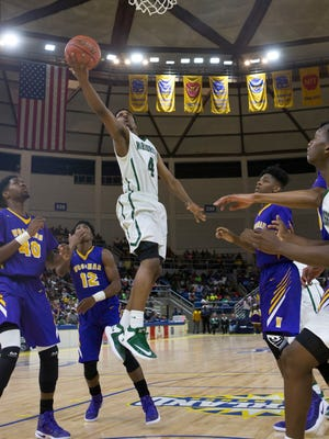 Peabody's Kyron Gibson (4) makes a layup against Wossman during the LHSAA boys' Class 3A basketball championship game in Lake Charles.