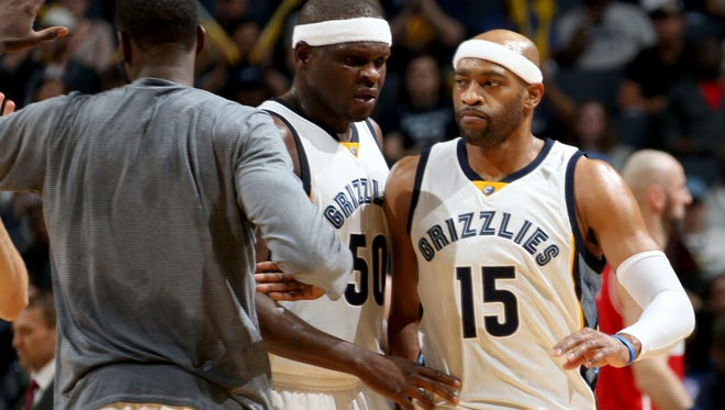 Memphis Grizzlies Zach Randolph and Vince Carter celebrate a Grizzlies run by the second unit against the Washington Wizards at FedExForum.