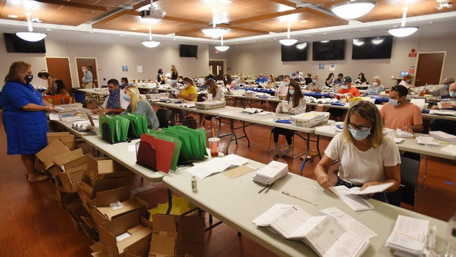 Ballot Board workers open each ballot at Two Bergen County Plaza in Hackensack on 07/15/20.