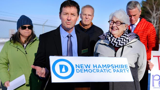 Sen. Tom Sherman, of Rye, center, joins, from left, Catherine Corkery of the New Hampshire chapter of the Sierra Club, Rep. Dennis Malloy of Greenland, Sen. Martha Fuller Clark of Portsmouth, and Rep. David Meuse of Portsmouth, outside Portsmouth International Airport for a PFAS press conference in January 2020.