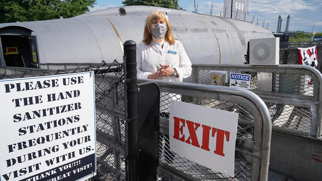 Executive Director Patti Violette exits the Albacore in Portsmouth, where they are safely conducting tours of the dry-docked submarine at Albacore Park.