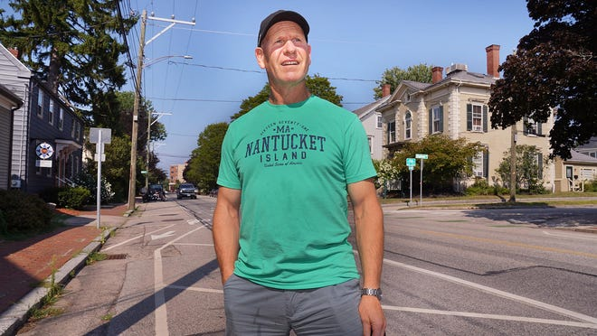 Bicyclist Dave O'Neill of Greenland walks along the Middle Street bike lane in Portsmouth where he was injured by a car door being opened into the lane during a July 26 ride.