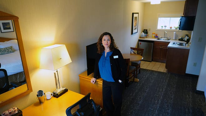 Martha Stone, executive director of Cross Roads House in Portsmouth, is seen at the Port Inn and Suites on the Route 1 Bypass, which has supplemented the shelter's capacity during the COVID-19 pandemic. Area homeless shelters fear a surge in demand as the moratorium on evictions expires.