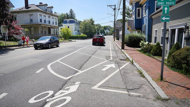 Cars travel Monday in the area of 456 Middle St. in Portsmouth, where a bicyclist was hit with a car door opened into the Middle Street bike lane on Sunday.