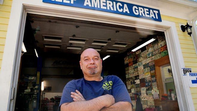 Rob Roy, owner of Rob Roy Auto on Main Street in Salisbury, Massachusetts, is a supporter of President Donald Trump. Most of Roy's political signs are against the Democratic Party. Roy displays different controversial political signs each day outside his auto shop.