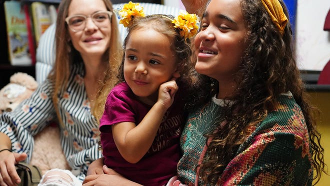 Amber F. smiles with her two children Zarah, 3, and Suniyah, 10, at New Generation in Greenland where they lived for nine months before getting their own apartment in Portsmouth.