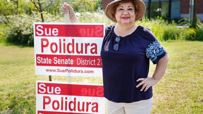 N.H. state Senate candidate Sue Polidura of Portsmouth campaigns outside of the polls at Portsmouth High School on Primary Day in September.