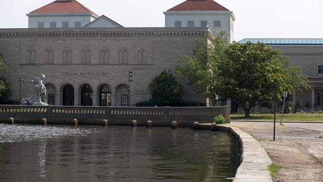 Water rises during high tide at the inlet near the Chrysler Museum of Art, seen May 28, 2014 in Norfolk, Virginia. Illustrates