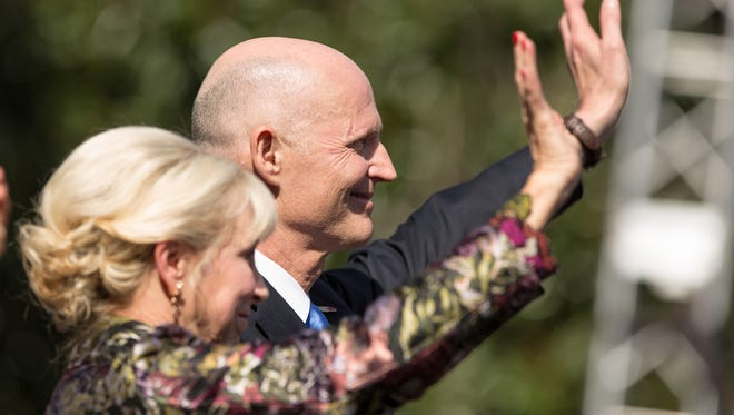 Florida Gov. Rick Scott and First Lady Ann Scott wave to the crowd during the swearing-in ceremony for Gov. Rick Scott and Lt. Gov. Carlos Lopez-Cantera on Tuesday, January 6, 2015, in Tallahassee, Fla.