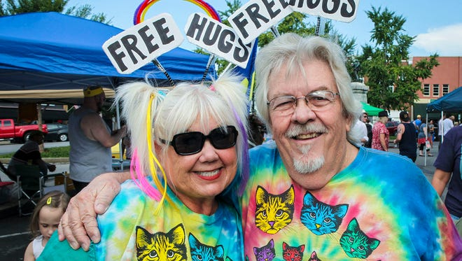 Murfreesboro residents Anna Grupke, left, and Don Hutchison circled the Rutherford County Courthouse Square giving free hugs during the Murfreesboro Pride #BoroPride festival Saturday.