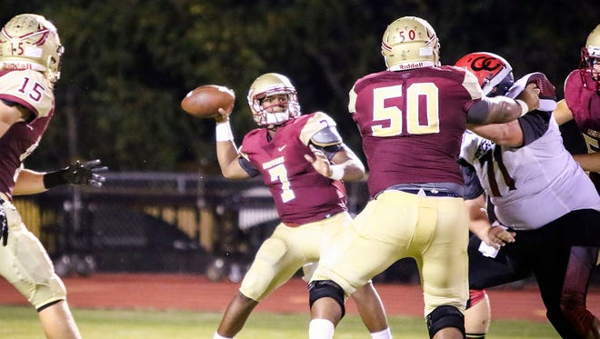 Riverdale quarterback Christian Souffrant fires a pass during a recent game against Coffee County.