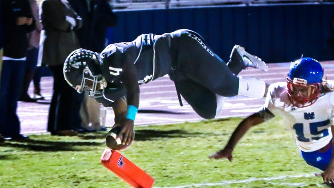 Siegel's Rodney Murray dives into the end zone over Warren County defender Noah Campbell to score the last Siegel touchdown of the first half Friday.
