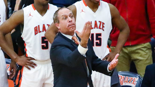 Blackman coach Barry Wortman instructs his team during a recent game. Wortman's squad saw its season come to a close with Monday's 72-68 loss to East Hamilton in the Class AAA Sectional.