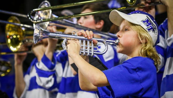 Eli Deml plays the trumpet with MTSU's pep band on Thursday during the game against Florida International.