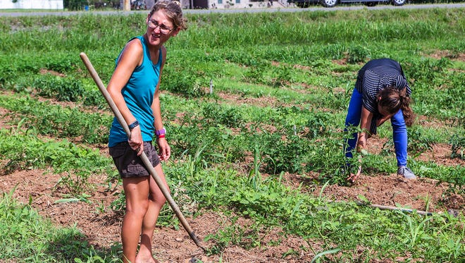 The Journey Home Garden, managed by Beck Wilson, provides jobs for clients like Patrisha Darling, background.
