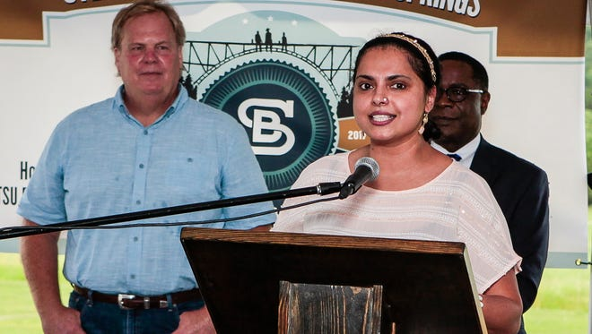 Maneet Chauhan, a founding partner in Life Is Brewing LLC, speaks at the groundbreaking for Steel Barrel Brewery at Hop Springs as brewery co-founder Mark Jones, left, and MTSU President Sidney McPhee look on.