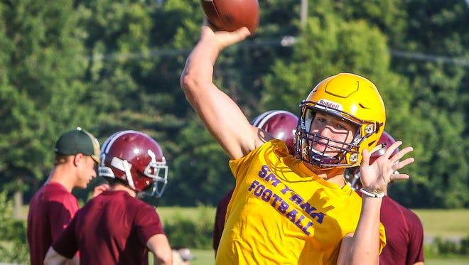 Smyrna senior quarterback Caleb Perkins fires a pass during 7-on-7 action Tuesday.