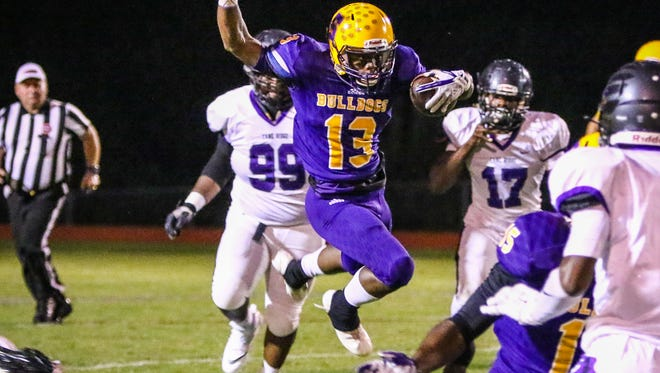 Smyrna's Trae Brimm leaps as he tries to get through the Cane Ridge defense.