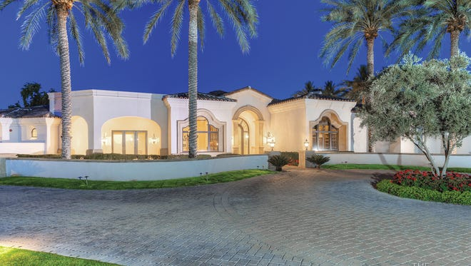 Aarshiwad LLC paid cash through their trust for this 9,889-square-footestate inParadise Valley's gated Villaresi community.