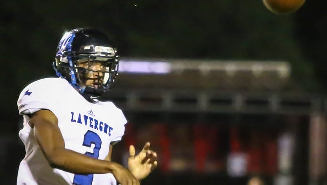 La Vergne quarterback Keianthony Conner fires a pass during Friday's 6A state playoffs loss at Ravenwood.