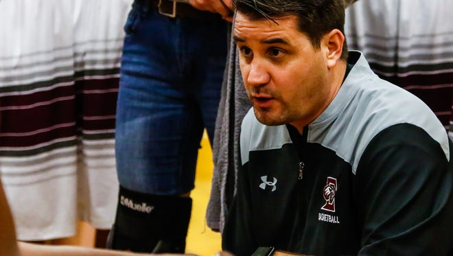 Eagleville boys basketball coach Joseph Reed talks to players during a game earlier this season. Eagleville coaches, players and fans are questioning how the scoring was handled during an overtime loss to LEAD Academy in the Region 4-A tournament Saturday.