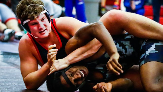 Oakland's Branson Boone (left) battles Franklin County's LaVaughn Rand during Saturday's Red Hawk Rampage. Boone won the 220-pound division.