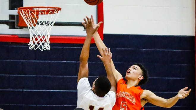 Blackman's Gabriel Martin (5) and Riverdale's Deron Perry battle for a rebound during Thursday's Region 4-AAA championship game, won by the Blaze 48-37.