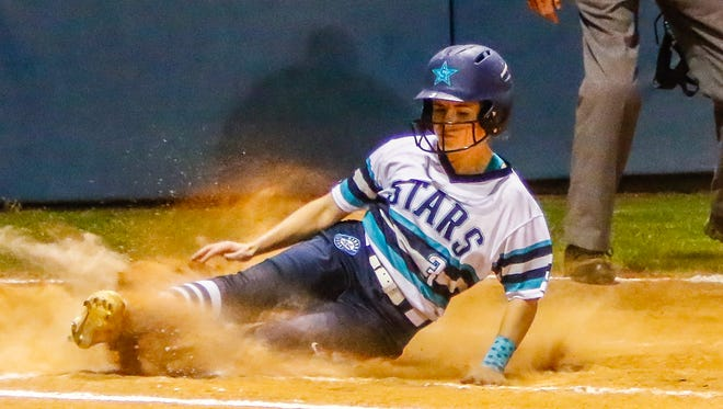 Siegel's Vanessa Westfall slides home during the Lady Stars' 4-3 win over Blackman Tuesday.
