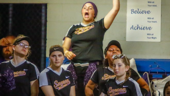 Smyrna players cheer the team on during Wednesday's 7-AAA championship game.