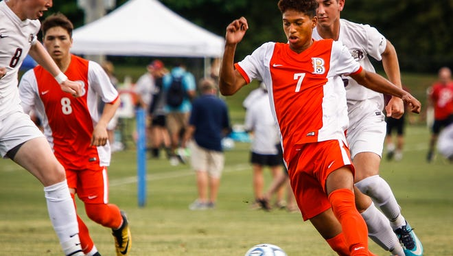 Blackman's Nemo Lazo beats a Dobyns-Bennett defender to the ball during Tuesday's state tournament.