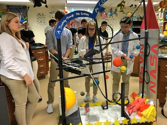 "Buckeye High School seniors in Advanced Placement physics test their marble roller coasters Monday, including the  NASA-themed ""A Journey through the Galaxy: Comet's Chaos."""