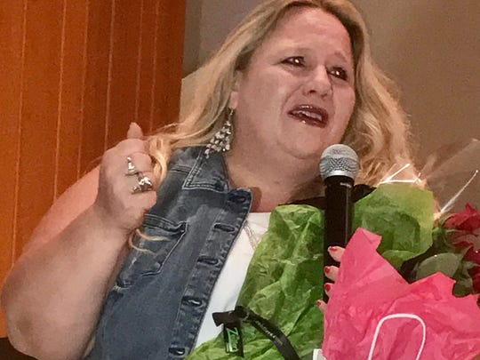 Talent show Sycamore Services' event organizer Kelly Fickas reacts with emotion after she was recognized for her long term efforts in helping people with developmental disabilities. The Sycamore Services talent show took place at Deaconess' Johnson Hall.