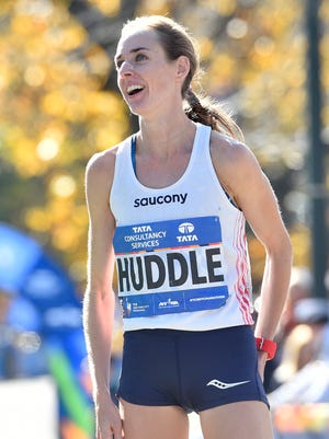 Molly Huddle reacts after crossing the finish line in third place of the Professional Women's division at the 2016 TCS New York City Marathon.
