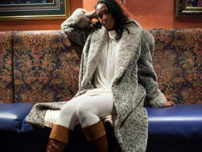 Shariyfa Fields wears a sweater dress and tights from Marshall's with Nine West boots and a coat from Salvation Army.