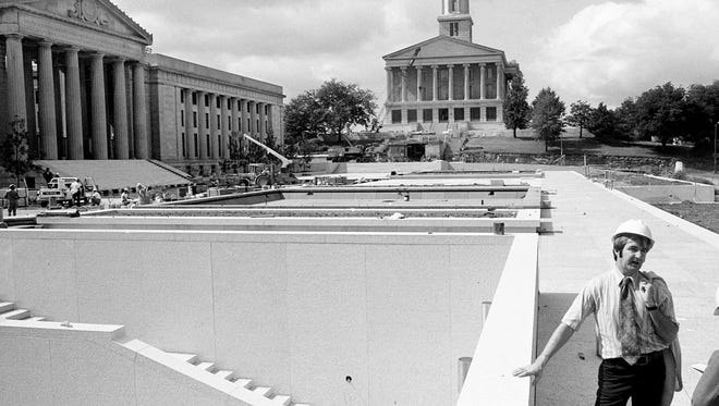Mike Fitts, the state architect for Tennessee, talks about the $8 million War Memorial Plaza legislative office building Sept. 6, 1974. Fitts said they are pushing for a December completion date, and one of the first events expected is the inauguration of a new governor in mid-January.