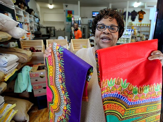 Pat Bannerman, owner of Mawuhi African Market at the corner of North Winooski Avenue and North Street, carries a wide range of products, from specialty African foods and staples, to wigs.