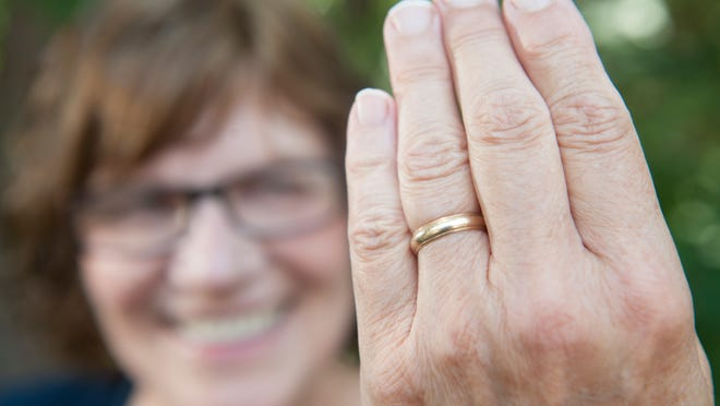 Sara Thurston of Franklinville in her yard, where she lost her original wedding ring while doing yardwork. She now wears her mother's ring. Below: Engagement rings on display at Fera's Jewelers in Williamstown.