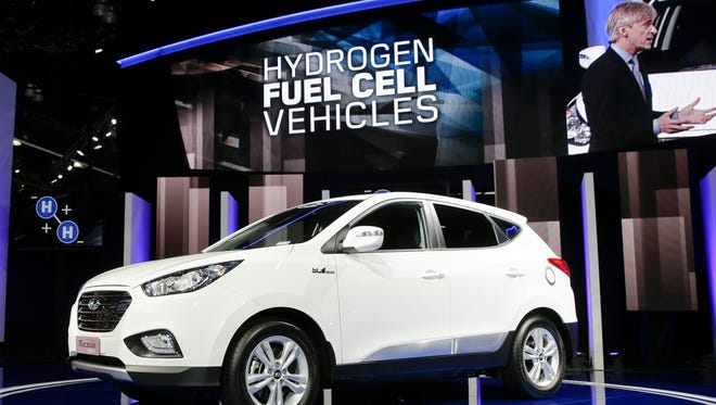 Hyundai introduces the Tucson Fuel Cell hydrogen-powered electric vehicle at the Los Angeles Auto Show in 2013