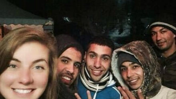 Carly Harris and Soufiane El Yassami with two others at Camp Moria. (Photo courtesy of Carly Harris)