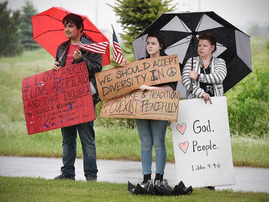 Protesters gathered outside Granite City Baptist Church before controversial preacher Usama Dakdok spoke Friday, May 27, in St. Cloud.