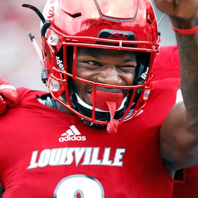 Louisville's Lamar Jackson is all smiles after scoring