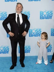 Alec Baldwin and daughter Carmen attend 'The Boss Baby'