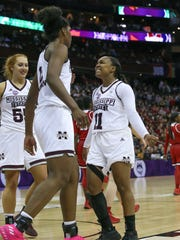 Mississippi State's Roshunda Johnson (11) and Mississippi State's Teaira McCowan (15) celebrate the victory. Mississippi State played Louisville in the semifinal round of the NCAA Women's Basketball Tournament in Columbus, Ohio, on Friday, March 30, 2018. Photo by Keith Warren