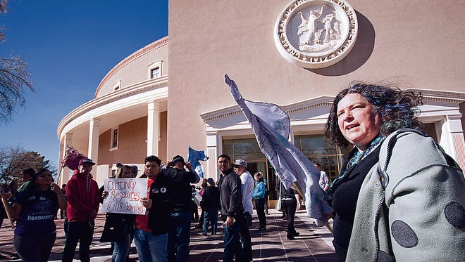 Lauren Reichelt, health and human services director for Rio Arriba County, leads a protest on Saturday outside New Mexico Capitol in Santa Fe.